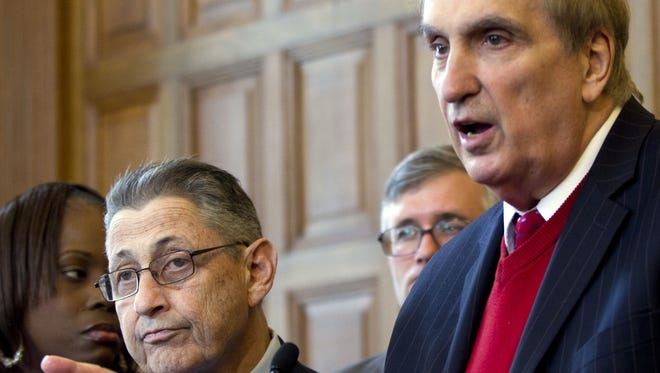 In this April 18, 2012, file photo, then- Assemblyman Vito Lopez, D-Brooklyn, right, and then-Assembly Speaker Sheldon Silver, D-Manhattan, appear at an Albany news conference. Lopez has been accused  of sexual harassment. Silver had been criticized for not doing more to crack down on harassment in the chamber.