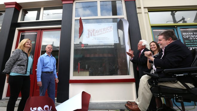Marlene and Paul Picton, of Newport, left, unveiled their new business, the Maverick Chocolate Company at Findlay Market with Cincinnati vice mayor David Mann, and council members Amy Murray and Kevin Flynn. The Pictons hope to have the store opened in early June.
