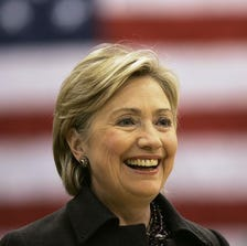 FILE - In this Dec. 31, 2007, file photo, then-Democratic presidential hopeful Sen. Hillary Rodham Clinton, D-N.Y., smiles while speaking at a campaign stop at Muscatine West Middle School in Muscatine, Iowa. Clinton last left Iowa on an ?excruciating? night, the beginning of the end of her White House campaign. She returns for the first time this weekend, not quite yet running for president, but sure to hear cheers from a crowd of Democrats hoping she will.