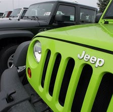 Jeeps sit for sale at a Chrysler dealership in Springfield, Ill.