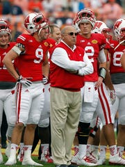 Wisconsin AD and former Badgers coach Barry Alvarez has twice filled in as interim head coach for bowl games after his coaches left for other jobs. It happened most recently before the Outback Bowl at the end of the 2014 season.