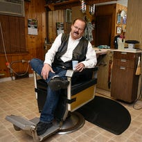 Tom Becker, owner of Toms Barber Shop, has decorated his shop over the years Wednesday, June 22, in St. Cloud.