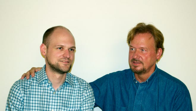 In this Sept. 2013 photo provided by Rev. Frank Schaefer shows Schaefer, right,  and his son Tim.