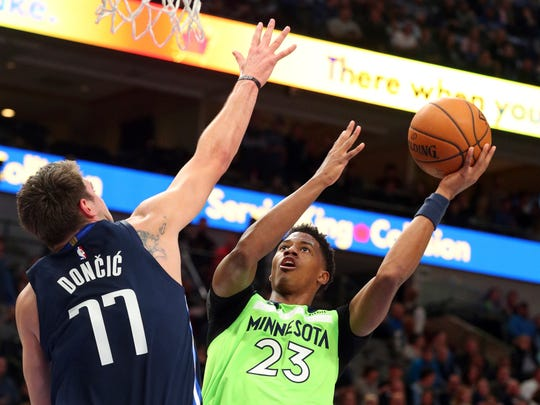 Dallas Mavericks forward Luka Doncic (77) tries to defend against a shot by Minnesota Timberwolves guard Jarrett Culver (23) in the first quarter In an NBA basketball game Wednesday, Dec. 4, 2019, in Dallas. (AP Photo/Richard W. Rodriguez)
