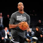 February 23, 2014; Los Angeles, CA, USA; Brooklyn Nets newly signed player Jason Collins practices before playing against the Los Angeles Lakers at Staples Center.