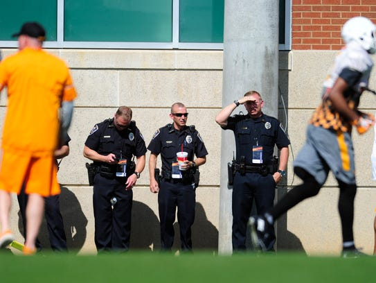 Law enforcement officials attend during Tennessee Volunteers