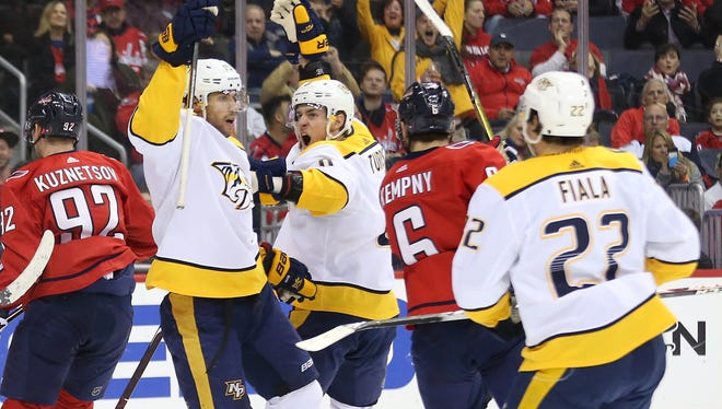 Apr 5, 2018; Washington, DC, USA; Nashville Predators right wing Craig Smith (15) celebrates with teammates after scoring a goal against the Washington Capitals in the second period at Capital One Arena.