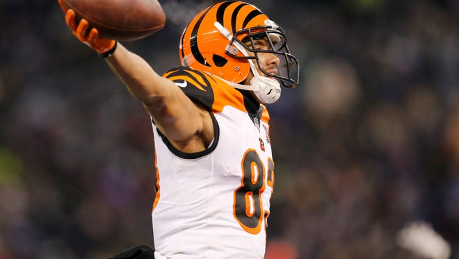 Cincinnati Bengals wide receiver Tyler Boyd (83) throws his hands up as he crosses into the end zone for a game winning touchdown in the fourth quarter of the NFL Week 17 game between the Baltimore Ravens and the Cincinnati Bengals at M&T Bank Stadium in Baltimore on Sunday, Dec. 31, 2017. The Bengals won 31-27 in the regular season finale.