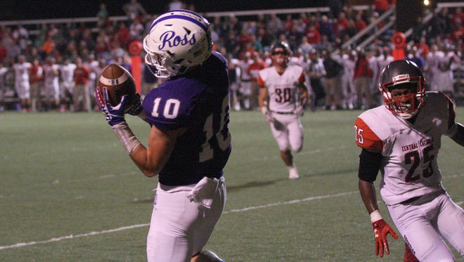 Ross' Devyn Jagodzinski catches a touchdown in the second quarter Friday against Central Catholic.