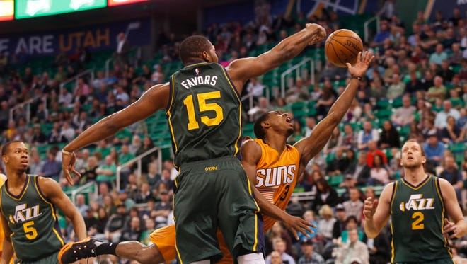 Utah Jazz's Derrick Favors (15) blocks a layup by Phoenix Suns' Brandon Knight (3) during the first half of an NBA basketball game Thursday, March 17, 2016, in Salt Lake City.