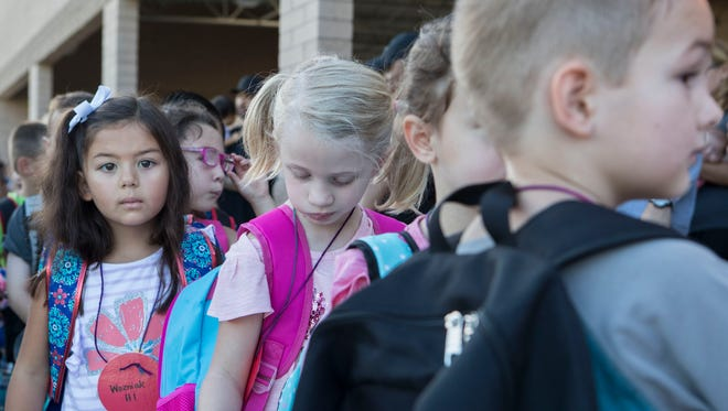 Kindergartners gather in line for the first day of school at Kyrene de las Lomas Elementary School on August 3, 2017 in Phoenix.