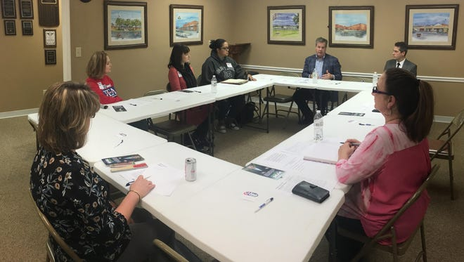Gubernatorial candidate Karl Dean, back, sat down with leaders from the Clarksville Montgomery County Education Association recently