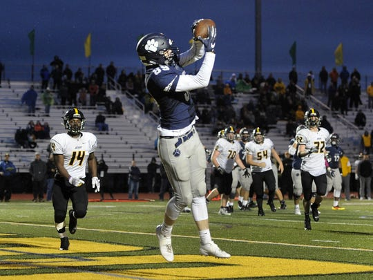 Pittsford's Kevin Ryan catches a touchdown pass to put the Panthers up 28-27 over McQuaid during the 2017 Section V Class AA semifinals. No. 1 seed Pittsford scored 35 unanswered points to advanced to the Class AA final. Ryan will be third-year starter in 2018.