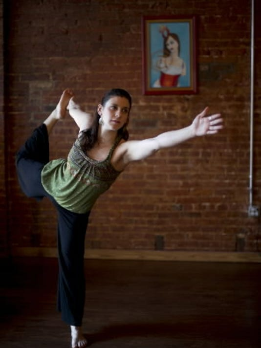 Megan Donley owns and teaches at Lotus Moon Yoga in York. Photo by York Daily Record/Sunday News -- Kate Penn.