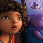 "In this image released by DreamWorks Animation, characters Oh, voiced by Jim Parsons, right, and Tip, voiced by Rihanna, appear in a scene from the animated film ""Home."""