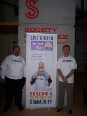 Dave Hodorff, left, vice president of operations for Wabash National Tank Trailer Division, and Rick Parks, president and CEO of Society Insurance, pose for a photo as co-pacesetters for the United Way's annual campaign.