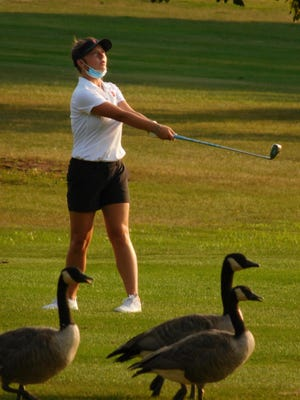 Pekin's Mylee Hansen has some company as she hits a shot vs. Dunlap on Tuesday on the executive nine-hole course at Kellogg Golf Course in Peoria.