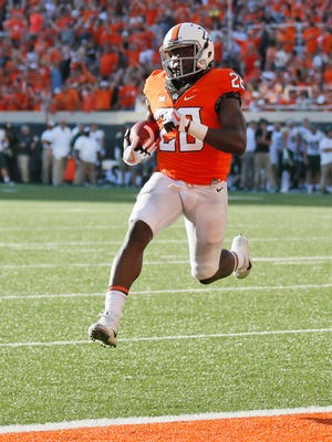 Oklahoma State wide receiver James Washington (28) runs into the end zone unopposed for a touchdown in the second half of an NCAA college football game against Baylor in Stillwater, Okla., Saturday, Oct. 14, 2017. Oklahoma State won 59-16.