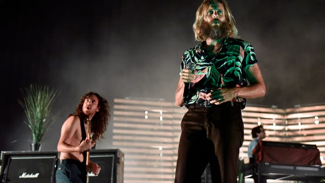 Zach Irons, left, and Aaron Bruno of Awolnation perform during the WKQX Piqniq Music Festival at the Hollywood Casino Amphitheatre on Saturday, June 30, 2018, in Tinley Park, Ill.