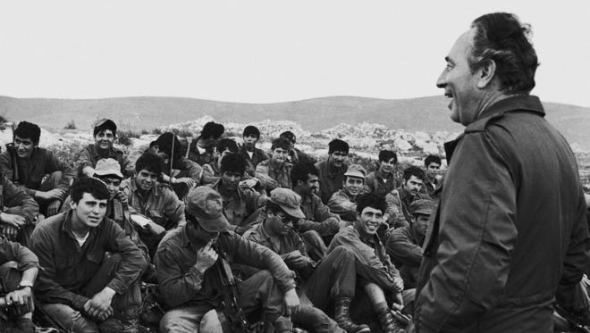 Former Israeli President Shimon Peres addresses Israeli paratroops in July 1976 after the completion of a military operation to rescue hostages held at Entebbe Airport in Uganda by members of the Popular Front for the Liberation of Palestine. At the time, Peres was Israel's defense minister.