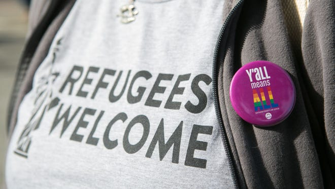 """ATLANTA, GA - FEBRUARY 04: """"Y'all Means All"""" button on a protestors shirt during an Interfaith Rally for Muslims and Refugees at the Lutheran Church of the Redeemer on February 4, 2017 in Atlanta, Georgia. Hundreds of activists gathered in Atlanta to protest President Trump's immigration ban. (Photo by Jessica McGowan/Getty Images)"""