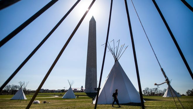 Indigenous protesters built seven tipis on the National Mall near the White House on Tuesday.