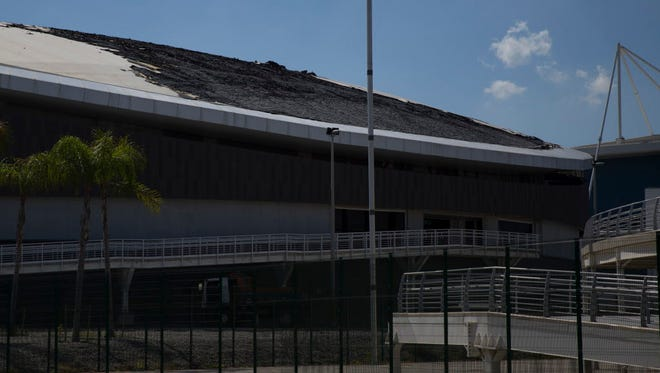 The charred roof of the velodrome is seen at the Olympic Park in Rio de Janeiro, Brazil. The velodrome built for last year's Rio de Janeiro Olympics suffered minor fire damage when it was struck by a small, hand-made hot-air balloon.