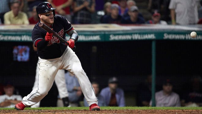 Cleveland Indians catcher Roberto Perez (55) hits a sacrifice bunt to score left fielder Brandon Guyer (not pictured) for a walk off win against the Boston Red Sox in the ninth inning at Progressive Field.