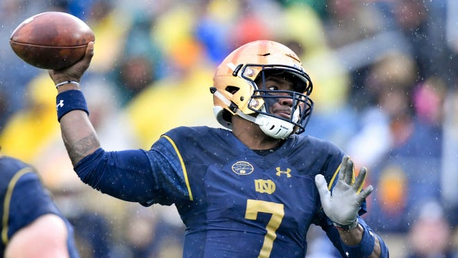 Notre Dame Fighting Irish quarterback Brandon Wimbush (7) throws in the first quarter against the Navy Midshipmen at Notre Dame Stadium.