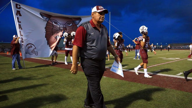 GABE HERNANDEZ/CALLER-TIMESCoach Phil Danaher walks with his players during the district 30-5A championship on Thursday Nov. 3, 2016, at Wildcat Stadium in Corpus Christi.