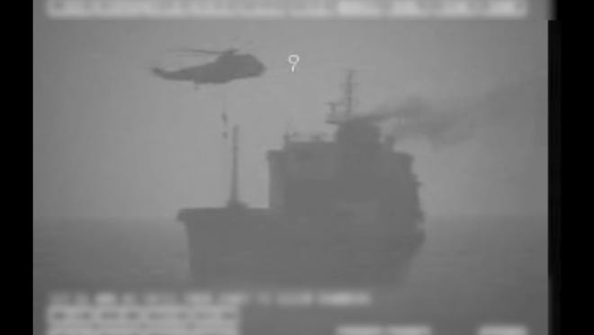 In this frame grab from video released by the U.S. military's Central Command, Iranian commandos fast-rope down from a helicopter onto the MV Wila oil tanker in the Gulf of Oman off the coast of the United Arab Emirates on Wednesday, Aug. 12, 2020. The Iranian navy boarded and briefly seized a Liberian-flagged oil tanker near the strategic Strait of Hormuz amid heightened tensions between Tehran and the U.S., a U.S. military official said Thursday, Aug. 13, 2020.