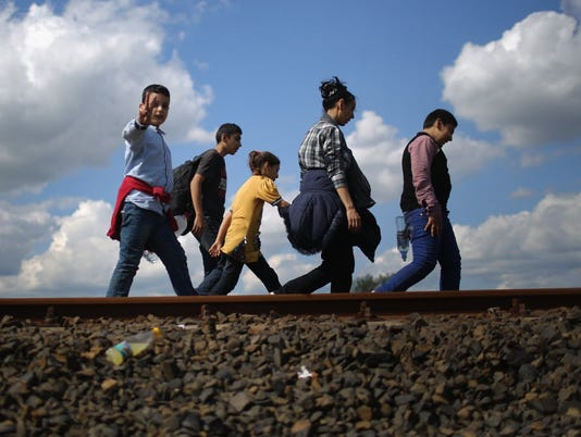 France, U.K. to accept 44,000 migrants as Europe copes with crisis