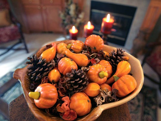 A simple bowl of gords and pine cones add spice to interior designer Robin Brechbuhler's new home in  North Canton, Ohio, Friday, September 22, 2006. (Phil Masturzo/Akron Beacon Journal/MCT)