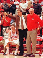 Dan Dakich (left) directs players on the court while Bob Knight works the referee during the Indiana-Penn State game Feb. 14 1996 in Assembly Hall.