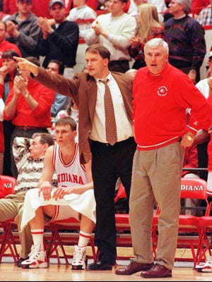 Dan Dakich left directs players on the court while Bob Knight works the referee during a 1996 Indiana-Penn State game. (Garrett Ewald, AP)