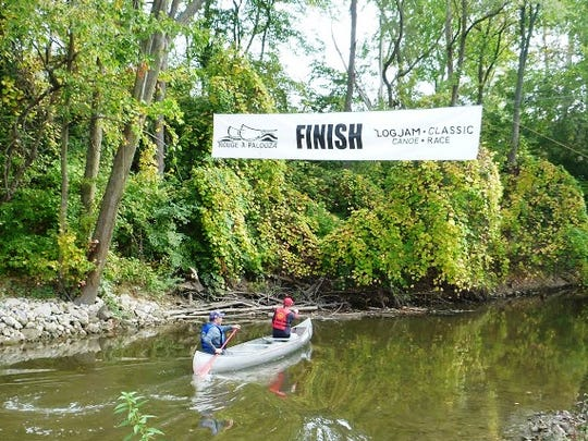 Jeff Barch of Livonia and Scott Spielman of Canton near the finish line in last year's Logjam Classic Canoe Race. They finished in third place.