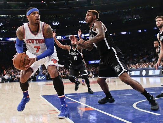 New York Knicks' Carmelo Anthony (7) looks for a shot as Brooklyn Nets' Sean Kilpatrick defends during the first half of an NBA basketball game Friday, April 1, 2016, in New York. (AP Photo/Frank Franklin II)