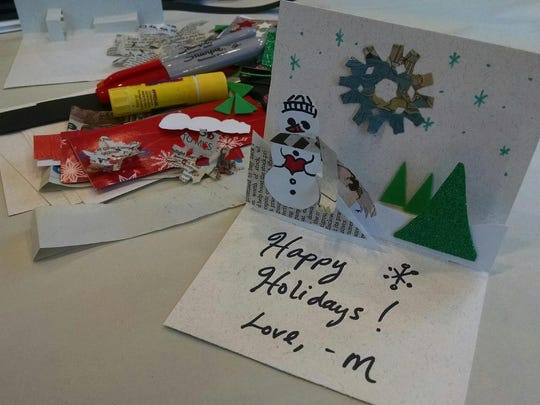 Visitors to the Sioux Falls Made Market can craft holiday cards with the Washington Pavilion.