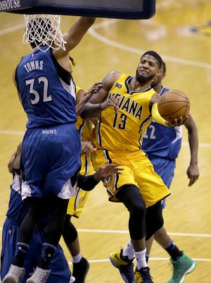 Indiana Pacers forward Paul George (13) drives on Minnesota Timberwolves center Karl-Anthony Towns (32) in the second half of their game Tuesday, March 28, 2017, evening at Bankers Life Fieldhouse.