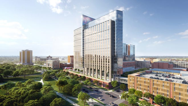 This rendering shows the planned 26-story hospital, envisioned for the area west of Ohio State University's James Cancer Center and Solove Research Institute. It is to be a glass-and-brick structure that will maximize the amount of light in patient rooms.