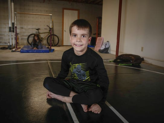 Sebastiano Fidone, 6, poses for a photo on a wrestling