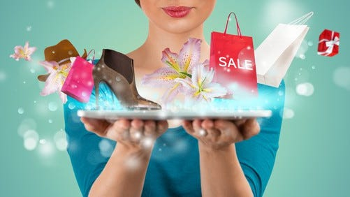 Woman holding purchases that sprang from her laptop