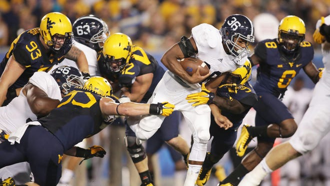 Georgia Southern running back Matt Breida (36) ranked first nationally in yards per carry (8.68) in 2014. The Eagles host Western Michigan on Saturday.