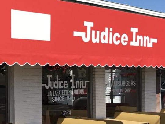 A new red canopy was installed at Judice Inn in Lafayette.