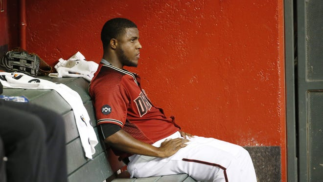 Arizona Diamondbacks starting pitcher Rubby De La Rosa (12) sits on the bench after being taken out in the second inning against the Colorado Rockies at Chase Field in Phoenix, Ariz. September 14, 2016.