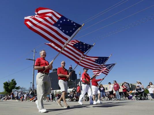 636625853624245359-memorial-day-parade.jpg