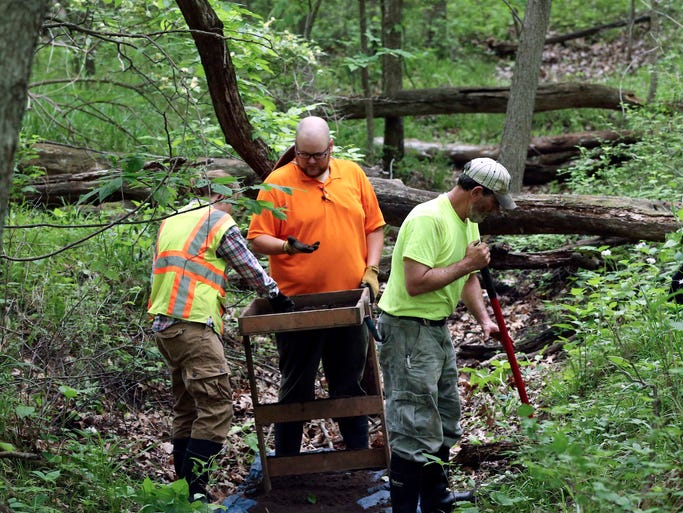 Pat Hashman digs in the ground as colleagues from Wapsi Valley Archeology Owen Reese and Anrea Einck work through loads of soil while working in a recently discovered World War I era training trench on Wednesday, May 28, 2014, at Camp Dodge in Johnston, Iowa.