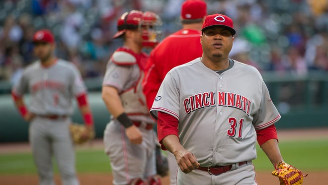 Cincinnati Reds starter Alfredo Simon leaves the field, during the fifth inning of a baseball game in Cleveland, Tuesday, May 17, 2016.