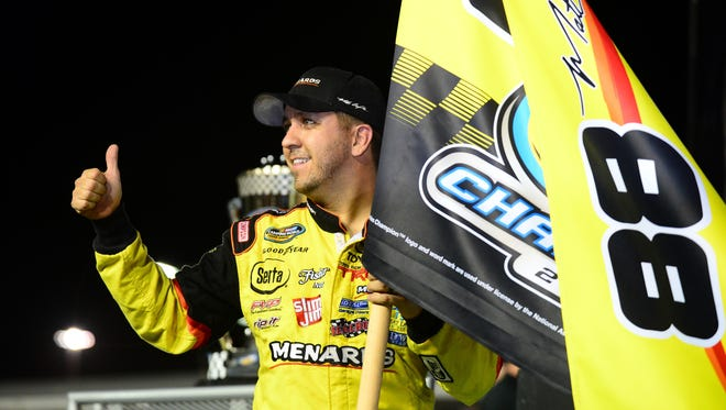 Matt Crafton won Camping World Truck Series titles in 2013 (above) and  again in 2014.