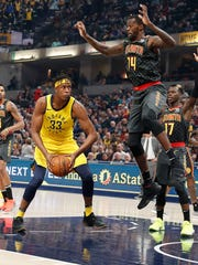 Mar 9, 2018; Indianapolis, IN, USA; Indiana Pacers center Myles Turner (33) goes up for a shot against Atlanta Hawks center Dewayne Dedmon (14) during the first quarter at Bankers Life Fieldhouse.